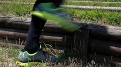 Close up shoes running, green park Stock Footage