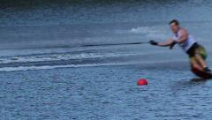 Waterskiing slalom competition slowmotion Stock Footage