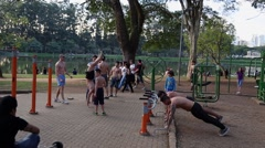 Guys are working out at Ibirapuera Park in Sao Paulo, Brazil. Stock Footage