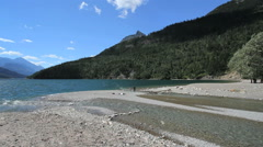 Canada Waterton Lakes NP stream enters lake Stock Footage