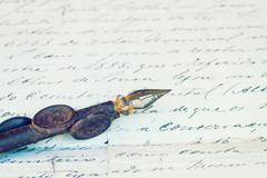 vintage quill pen and antique letter - stock photo