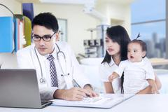 male pediatrician and his patient - stock photo
