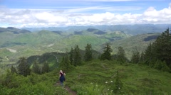 Hiker mountain trail , long scenic view - stock footage