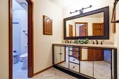 Luxury bathroom vanity cabinet in mirror trim Stock Photos