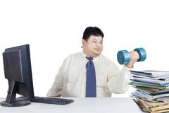 overweight man working while workout - stock photo