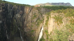 Voringsfoss Waterfall Hotel Fossen above the waterfall Western Norway Stock Footage