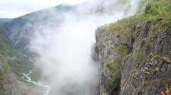 Spectacular view of mist raising from Voringsfoss Waterfall Western Norway Stock Footage