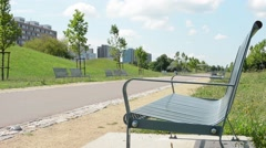 Benches in the park with housing estate (development)  Stock Footage