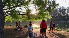 People enjoy the sunset at Ibirapuera Park in Sao Paulo, Brazil. Stock Footage
