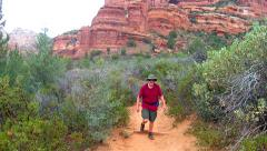 Man Hiking Trail Toward Camera In Boynton Canyon- Sedona AZ Stock Footage