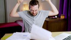 Man at home throwing in the air bills to pay angry slow motion - stock footage