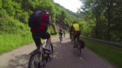 Many bikers downhill on a street - stock footage