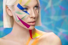 beautiful woman with art make-up - stock photo