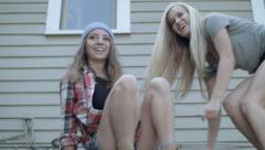 2 Excited Teen Girls Climb Up Onto Roof For Fun - stock footage