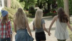 4 Teens Clap Their Hands, Dance Down An Alley And Hold Hands Stock Footage