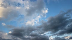 Dramatic dark clouds moving fast in the blue sky Stock Footage