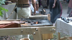 Burning coal for heating up iron during medieval week in Visby sweden Stock Footage