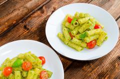 rigatoni pasta with genoese pesto and sherry tomato - stock photo