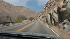 Dashboard view-driving winding two-lane canyon road in Kern Canyon, California Stock Footage