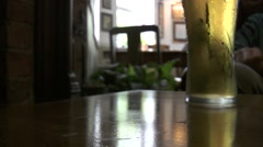 Stock Video Footage of Bubbly beer in pub, British pub culture