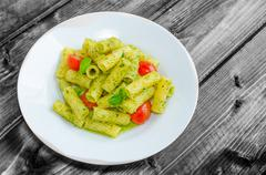 rigatoni pasta with genoese pesto and sherry tomato - stock photo