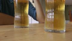 Close up of two beers being drunk in pub Stock Footage