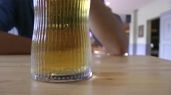 Stock Video Footage of Close up on bubbly beer in pub, British pub culture