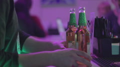 Anonymous buying alcohol at the bar in nightclub, clubbing - stock footage