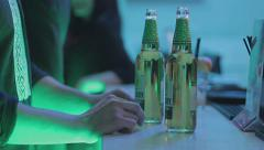 Person ordering bottled beer at the bar, enjoying nightlife Stock Footage