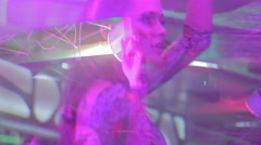 Blurred image of seductive Go-Go girl dancing on bar table Stock Footage