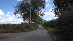 Rural Countryside Lane with Trees Wild Hedgerow Stock Footage