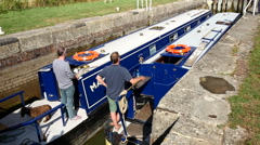 Caen Hill Canal Locks.  2 boats in a lock - stock footage
