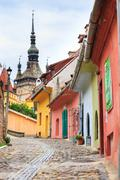 Medieval street view in sighisoara founded by saxon colonists in xiii century Stock Photos