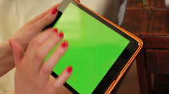 Female hands touching menus on tablet screen with alpha matte Stock Footage