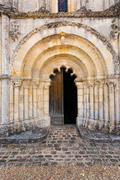 main door of petit palais et cornemp romanesque church gironde france - stock photo