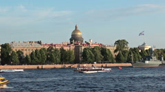 Admiralty embankment and Neva river with sightseeing boats passing Stock Footage