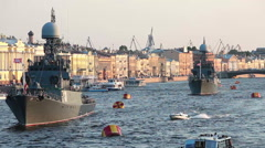 Camera zoom out from military ships on Neva river, Russia Stock Footage