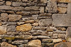 old stoned wall with bird flying in the bottom right side - stock photo