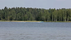 People waterskiing on the lake Stock Footage