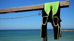 Drying surf wetsuit  close up - stock footage