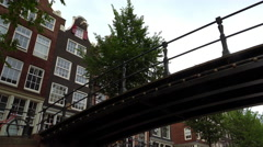 Small bridges and wonderful houses at the canals of Amsterdam Stock Footage
