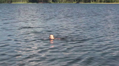 Active young child swimming in forest lake different styles Stock Footage