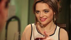 Attractive female clinking wineglasses with her partner on date Stock Footage