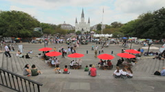New Orleans umbrellas Jackson Square with red umbrellas Stock Footage