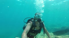 diver blowing bubbles under water, Antalya, Turkey 5 - stock footage