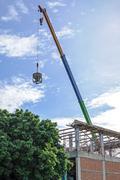 Crane hoist concrete bucket Stock Photos