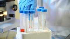 Laboratory technician looking at a blood sample Stock Footage