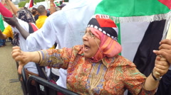 Old Palestinian lady protests against Israeli Jews - stock footage