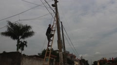 Asian man climbed the electric pole,Asia Stock Footage