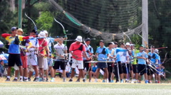 Athletes compete in archery in Asia - stock footage